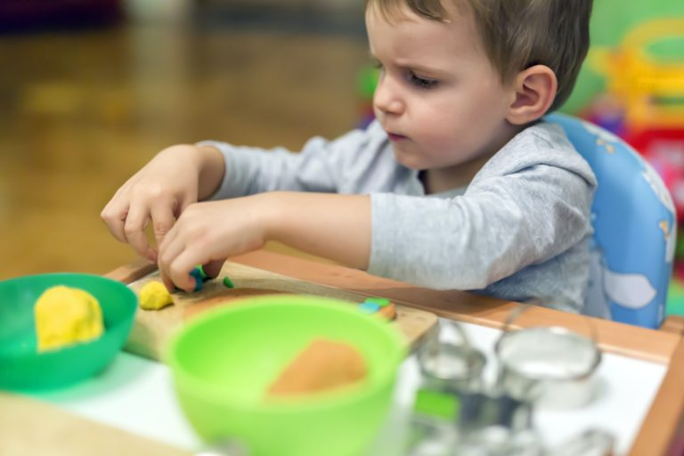 little-boy-working-with-clay.jpg